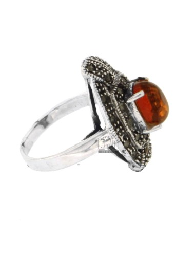 Oval ring with amber in...